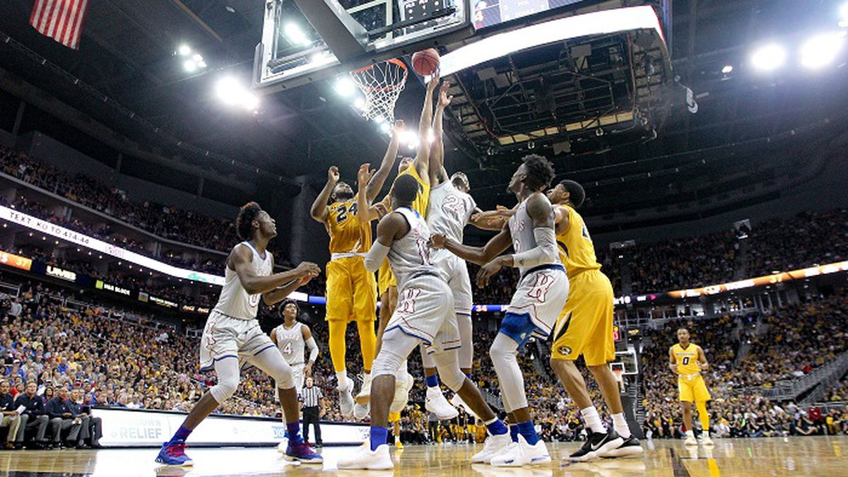KANSAS CITY, MO - OCTOBER 22: Kansas Jayhawks and Missouri Tigers go up for a loose ball during the preseason Showdown for Relief college basketball game between the Missouri Tigers and the Kansas Jayhawks on October 22, 2017 at Sprint Center in Kansas City, Missouri.  (Photo by William Purnell/Icon Sportswire) (Icon Sportswire via AP Images)