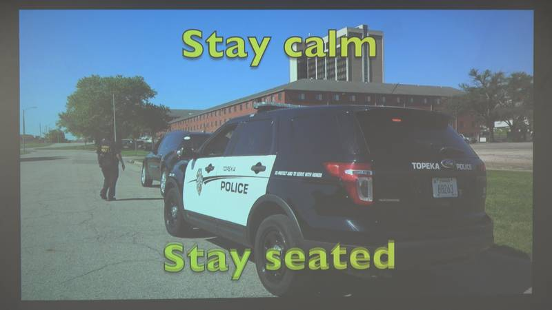 Topeka Law Enforcement host second community engagement meeting showing a video of how to...