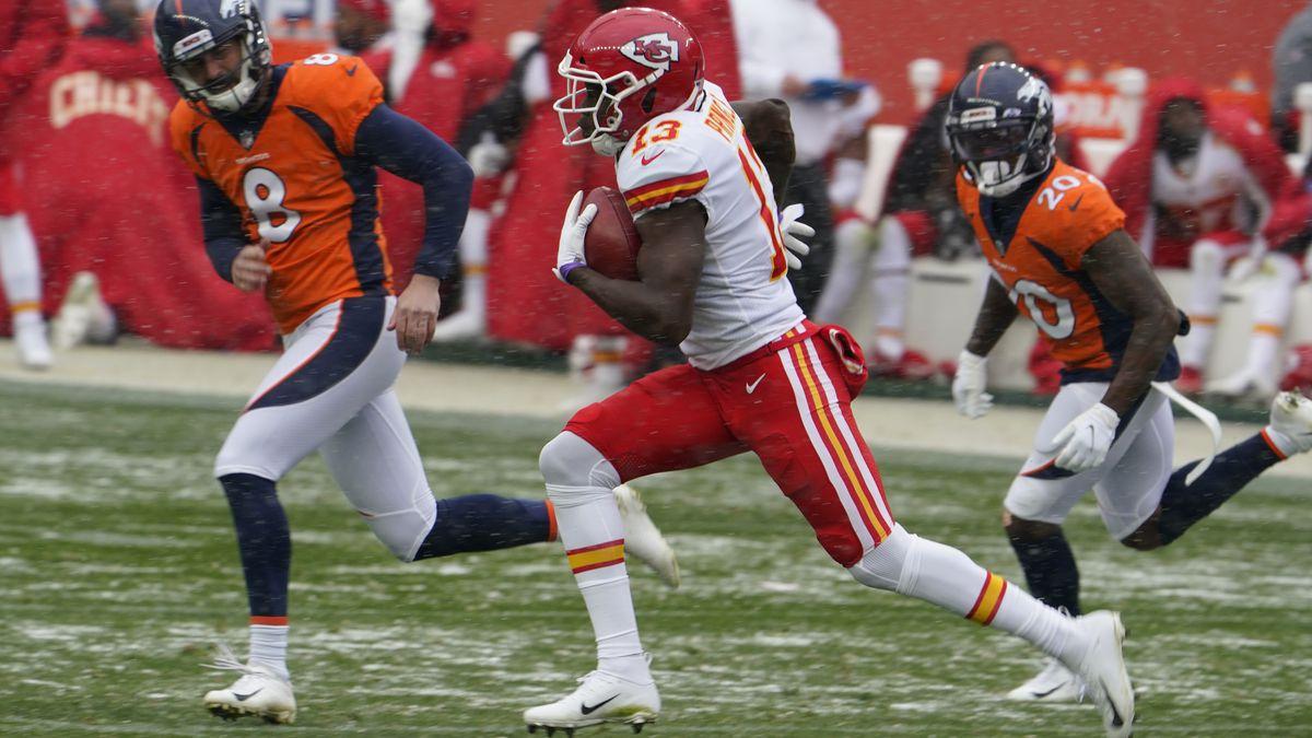 Kansas City Chiefs kick returner Byron Pringle runs a kickoff back for a touchdown as Denver...