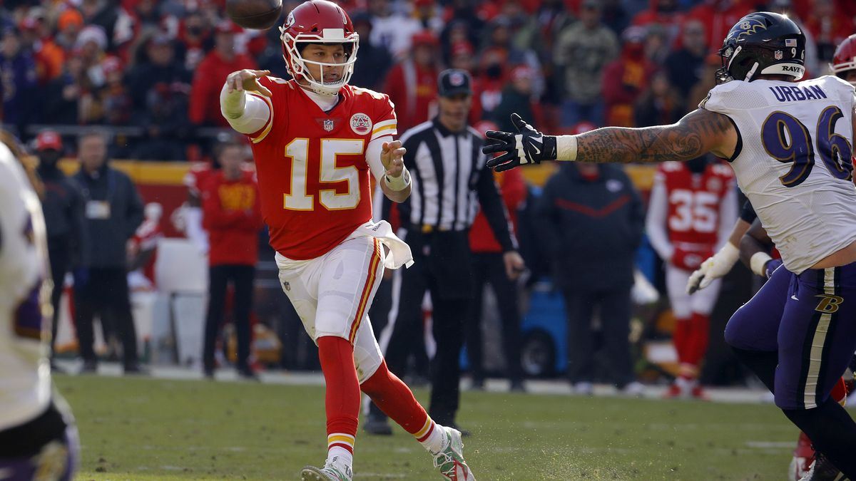Kansas City Chiefs quarterback Patrick Mahomes (15) throws on the run past Baltimore Ravens defensive end Brent Urban (96) during the first half of an NFL football game in Kansas City, Mo., Sunday, Dec. 9, 2018. (AP Photo/Charlie Riedel)