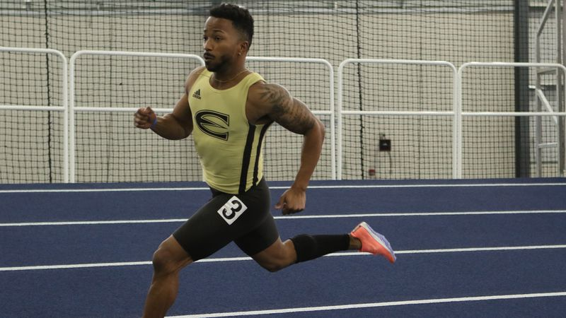 Emporia State sprinter Brandon Rhone rounds the corner at the Washburn Invitational.