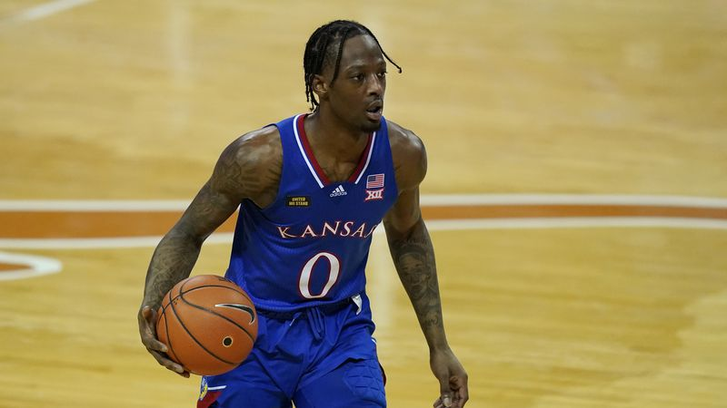 Kansas guard Marcus Garrett (0) during the second half of an NCAA college basketball game,...