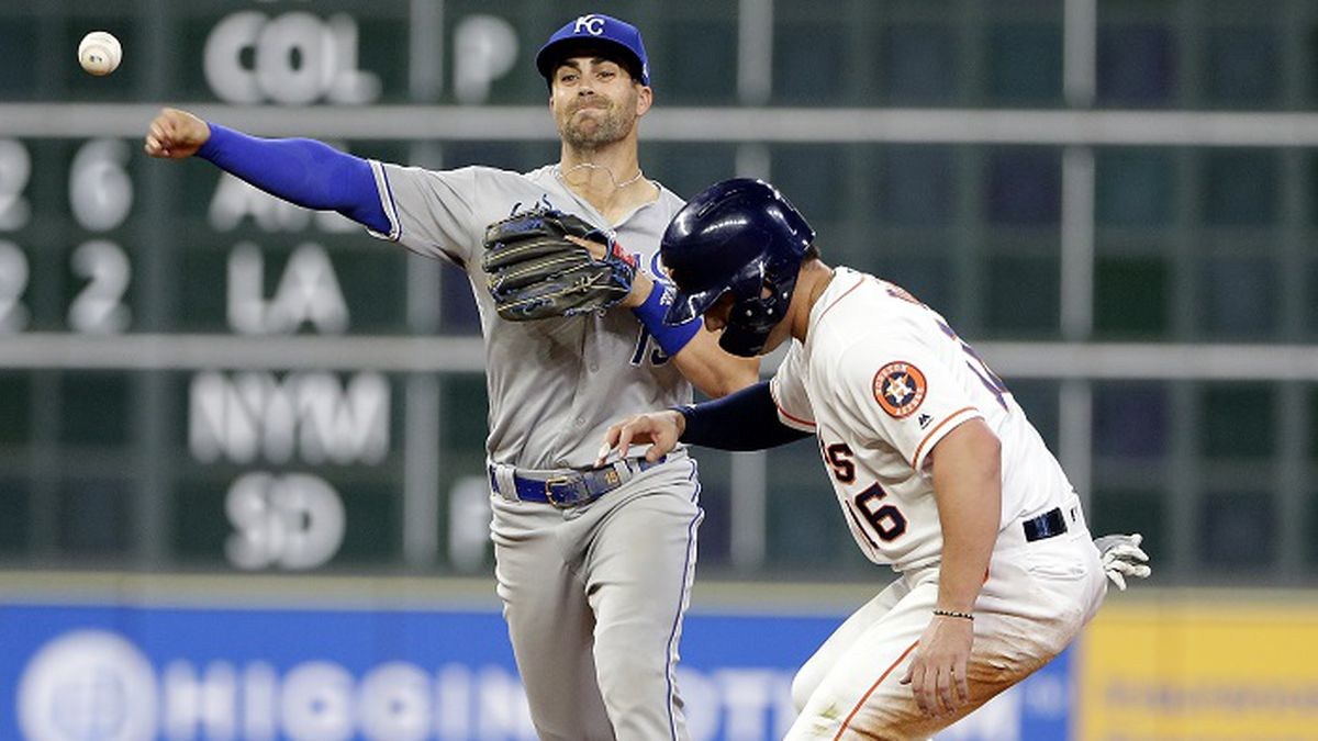 Kansas City Royals second baseman Whit Merrifield, left, turns the double play at second base as Houston Astros' Aledmys Diaz (16) is out on the force play during the fifth inning of a baseball game, Wednesday, May 8, 2019, in Houston. (AP Photo/Michael Wyke)