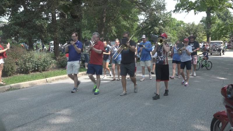 A band marches up Collins Ave. in Topeka on the 50th annual 4th of July parade on Sunday, July...