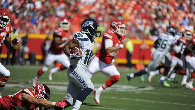 Seattle Seahawks wide receiver Tyler Lockett (16) runs past Kansas City Chiefs defensive back...