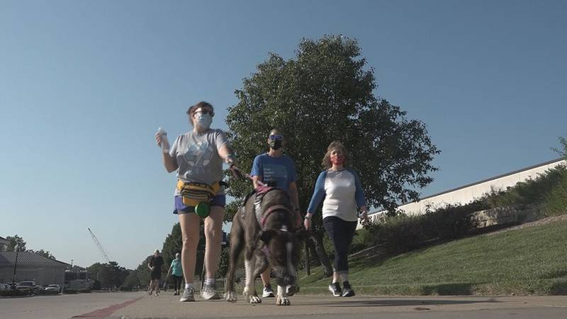 A group walks on Washburn University's campus at Walk with a Doc on Saturday, September 18, 2021.