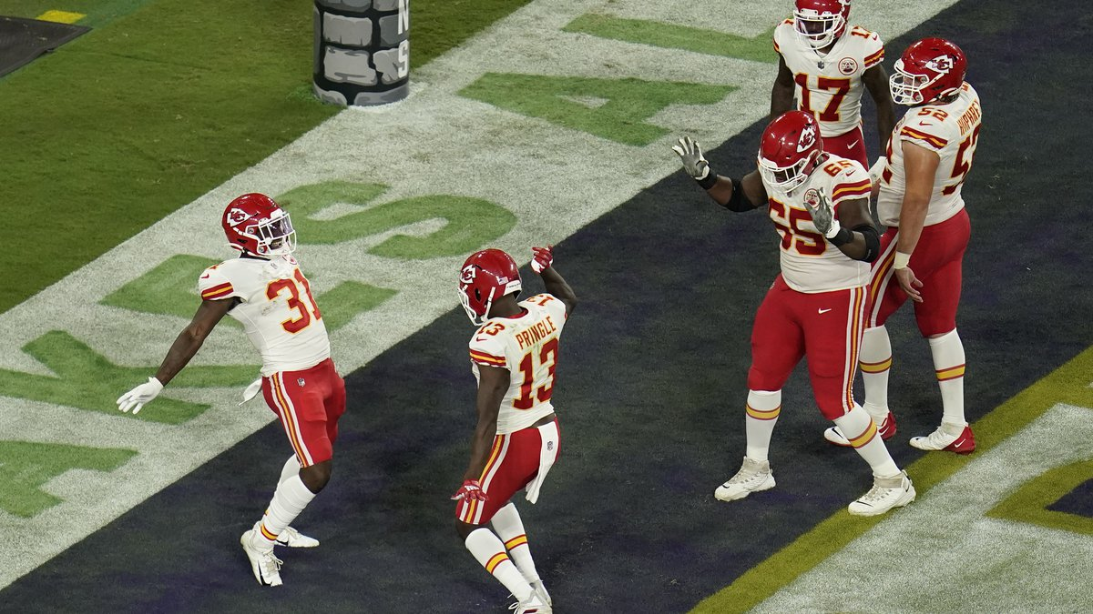 Kansas City Chiefs wide receiver Byron Pringle (13) celebrates his touchdown with teammates in...