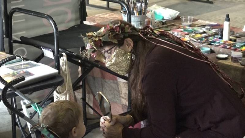 A child gets his face painted at Topeka Vendors Market Oktoberfest.