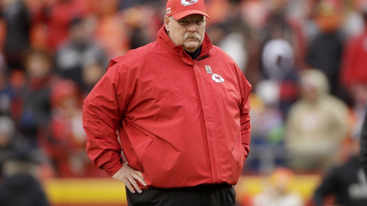Kansas City Chiefs head coach Andy Reid follows warmups before an NFL football game against...