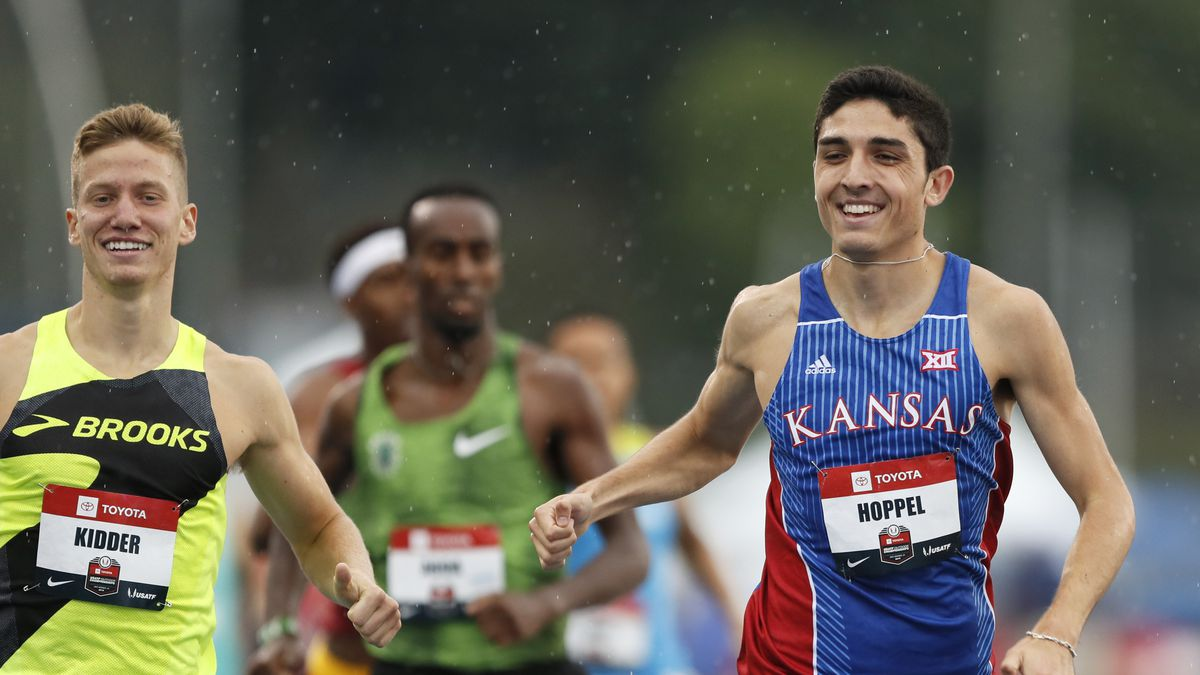 Bryce Hoppel beats Brannon Kidder, left, to the finish line in a preliminary heat in the men's...