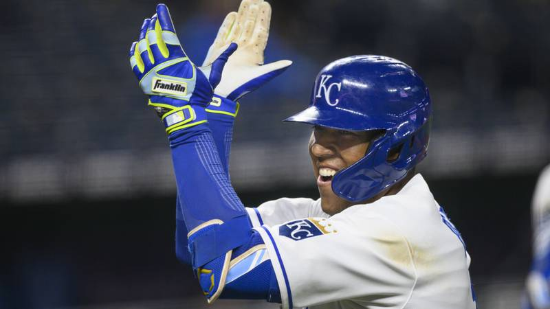 Kansas City Royals Salvador Perez celebrates after hitting a home run to give the Royals a lead...