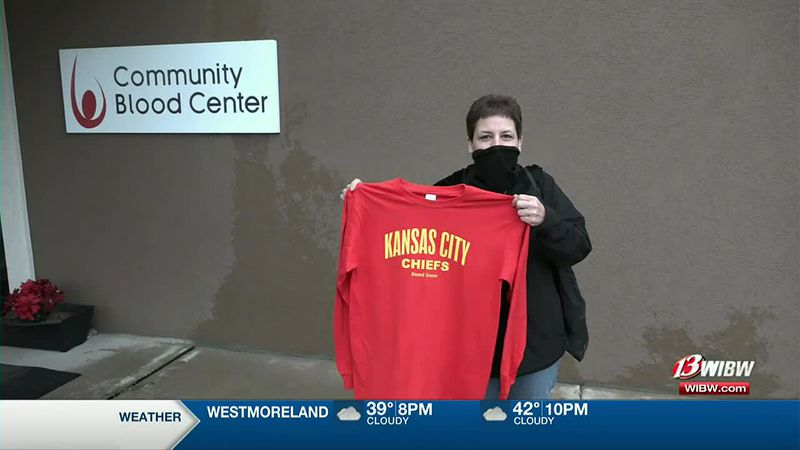 Sammi Peterson, a blood donor, shows off her free Chiefs shirt following a blood donation...