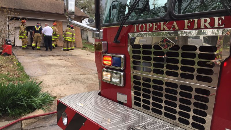A Topeka man was hurt after a spark from a grinder started a fire.