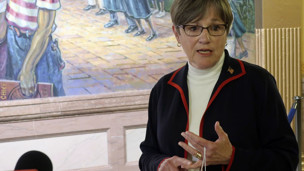 Kansas Gov. Laura Kelly answers questions from reporters about the coronavirus pandemic after a...