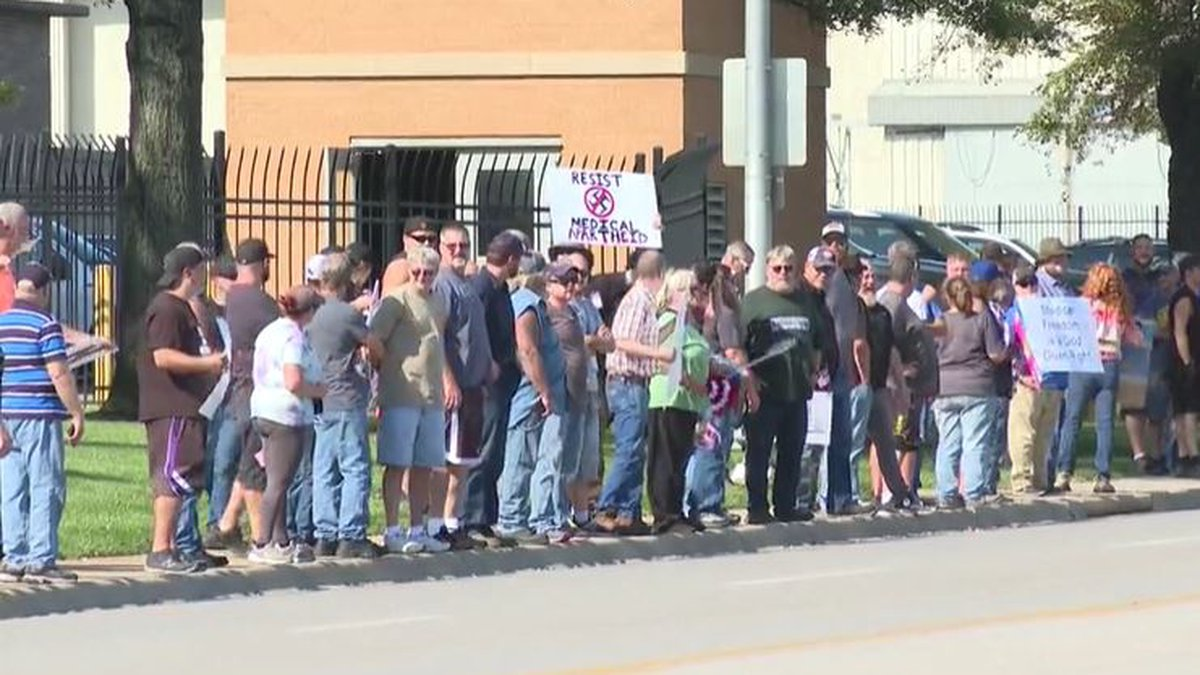 Spirit AeroSystems employees gather outside the company in Wichita in opposition to a COVID-19...