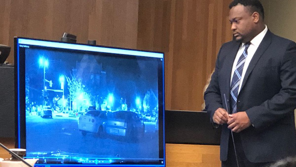 Former police officer Tyler Haney viewed dash cam video Thursday showing him running toward gunfire in Lawrence. Anthony Laron Roberts Jr. is charged with three murders. (WIBW/Steve Fry)