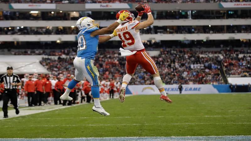 Kansas City Chiefs defensive back Daniel Sorensen, right, intercepts a pass intended for Los...