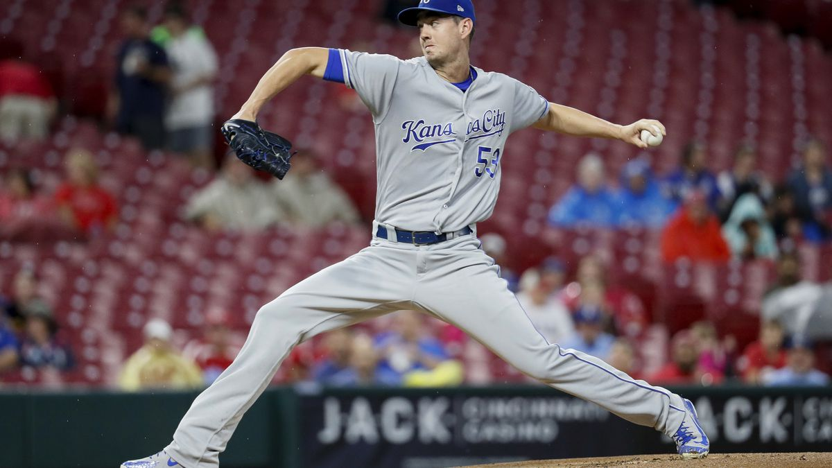 Kansas City Royals starting pitcher Eric Skoglund throws during the first inning of the team's baseball game against the Cincinnati Reds, Tuesday, Sept. 25, 2018, in Cincinnati. (AP Photo/John Minchillo)