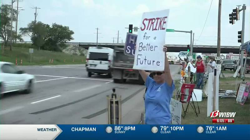 Baker's union members on the picket line on the 18th day of the strike on Thursday, July 22,...