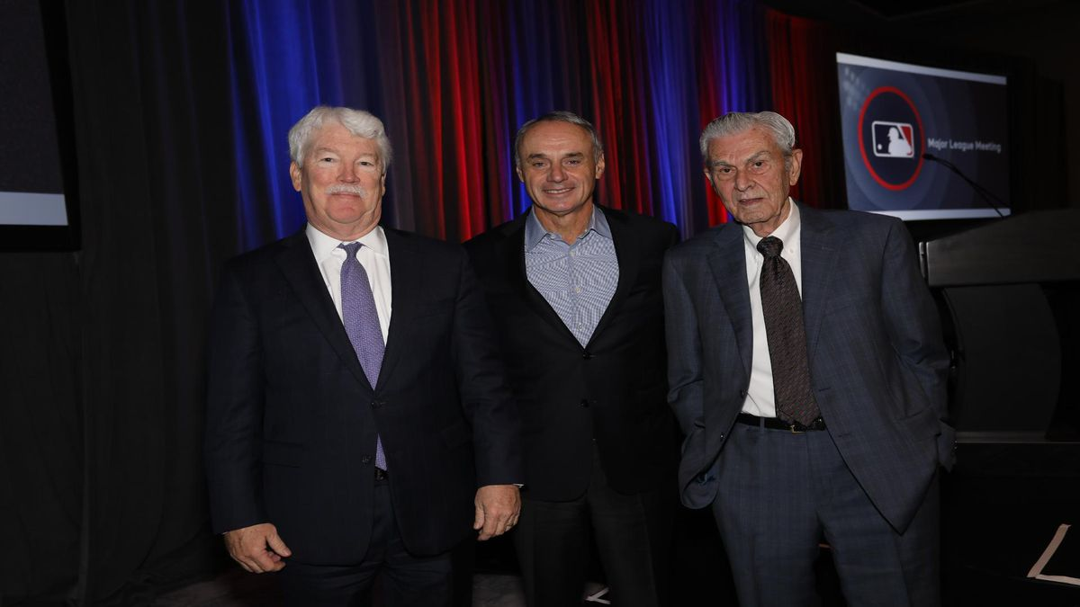 New Royals owner John Sherman (left) poses with Major League Baseball commissioner Rob Manfred (center) and former Royals owner David Glass (right). (Courtesy of the Kansas City Royals)