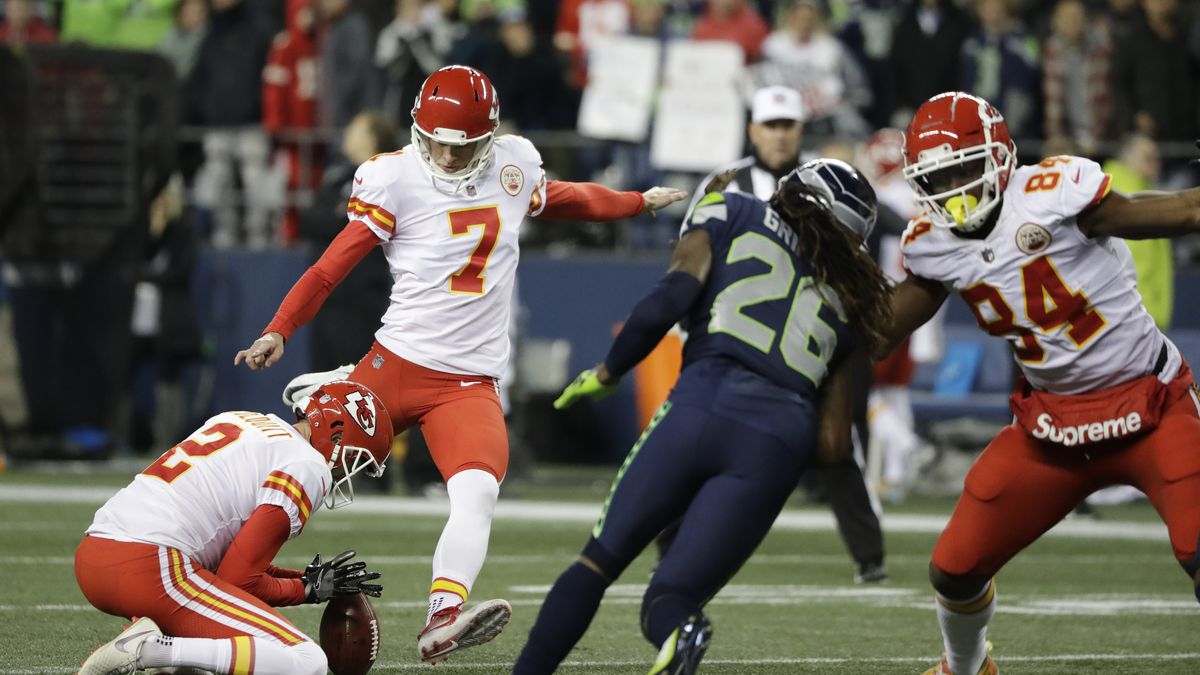 Kansas City Chiefs kicker Harrison Butker kicks a field goal as Dustin Colquitt (2) holds during the first half of an NFL football game against the Seattle Seahawks, Sunday, Dec. 23, 2018, in Seattle. (AP Photo/Elaine Thompson)