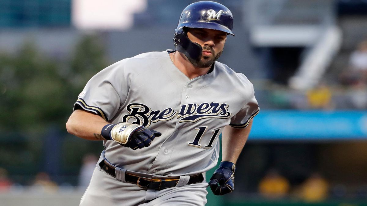 Milwaukee Brewers' Mike Moustakas rounds third after hitting a solo home run off Pittsburgh Pirates starting pitcher Dario Agrazal during the fourth inning of a baseball game in Pittsburgh, Monday, Aug. 5, 2019. (AP Photo/Gene J. Puskar)