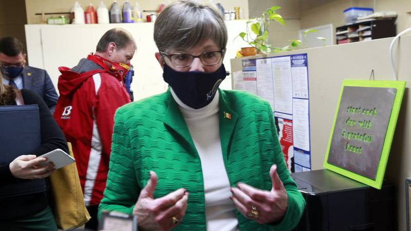 Kansas Gov. Laura Kelly answers questions from reporters following a tour of a childcare...