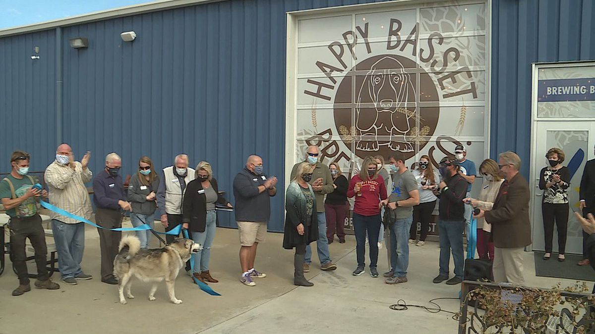 Happy Basset cuts ribbon on Barrel House