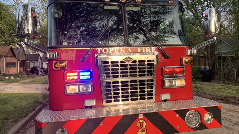 Topeka Fire Department crews put out a brush fire that produced a large amount of smoke early...