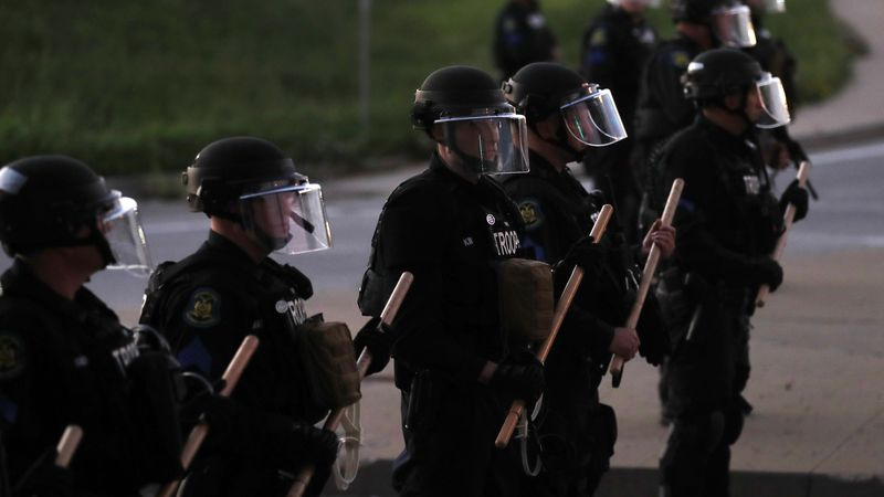 FILE: Members of the Missouri Highway Patrol block protesters from entering a highway,...
