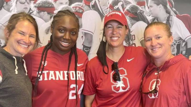 Topeka High pitcher Nija Canady poses with the Stanford coaching staff (from left to right:...