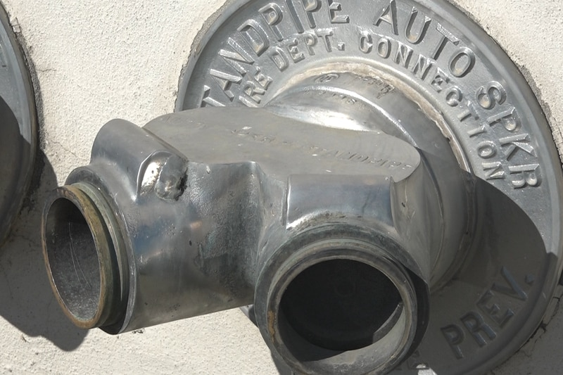 A standpipe with  a missing cover and adapter