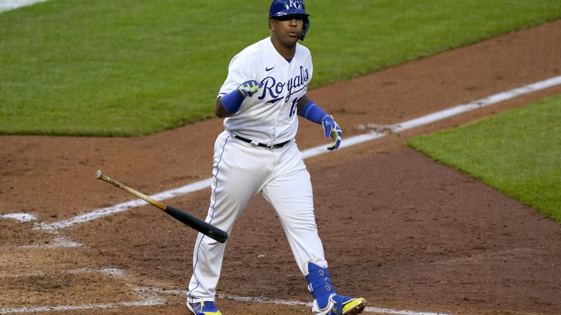 Kansas City Royals' Salvador Perez tosses his bat after hitting a walkoff home run during the...