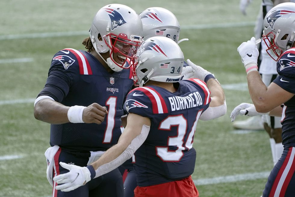 New England Patriots quarterback Cam Newton (1) celebrates his touchdown pass to running back...