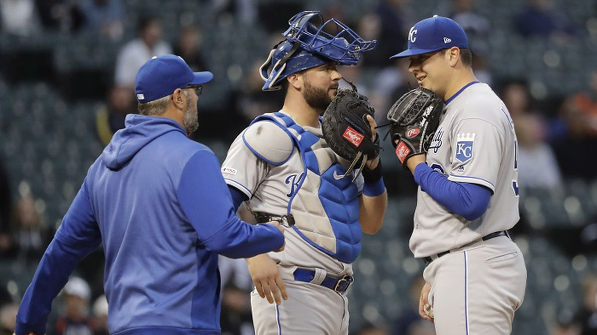 Kansas City Royals pitching coach Cal Eldred, left, visits catcher Cam Gallagher and pitcher Brad Keller on the mound during the third inning of a baseball game against the Chicago White Sox, Tuesday, May 28, 2019, in Chicago. (AP Photo/Charles Rex Arbogast)