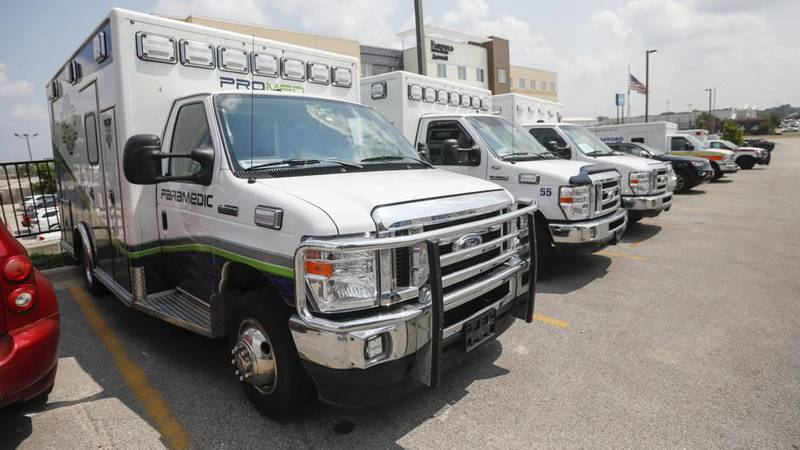 Ambulance crews unload equipment at the DoubleTree Hotel on Friday, July 23, 2021, in...