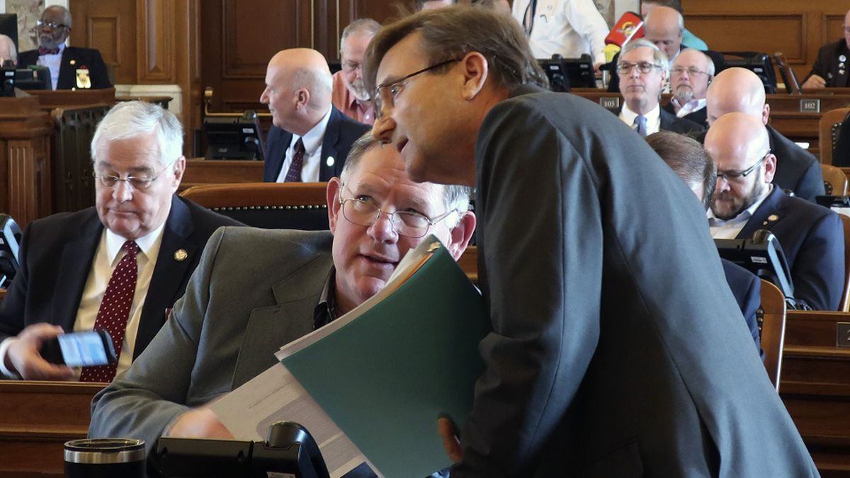 Kansas House Insurance Committee Chairman Jene Vickrey, right, R-Louisburg, confers with...
