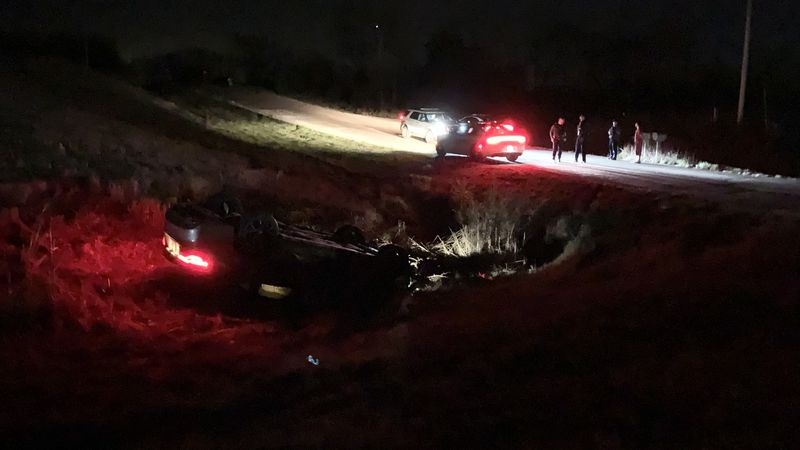 No serious injuries were reported when a car flipped onto its top early Tuesday in a ditch off...