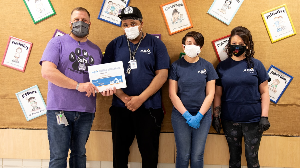 Spring Valley Elementary custodians are honored with the School of the Month award.