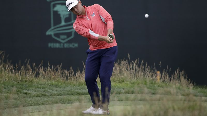 Gary Woodland chips off the 17th green during the final round of the U.S. Open Championship...