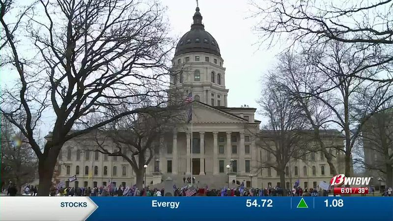 """Crowds gather at the Kansas Statehouse on Wednesday, January 6, 2021 at the """"United We Stand..."""