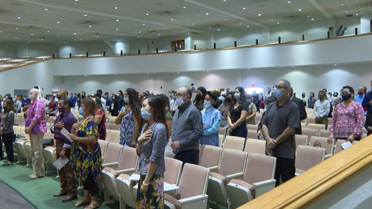 FILE - More than 100 people swear in during an Aug. 27 ceremony in Wichita to become new U.S....