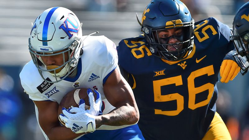 Kansas Jayhawks wide receiver Stephon Robinson Jr. (5) is tackled by West Virginia Mountaineers...