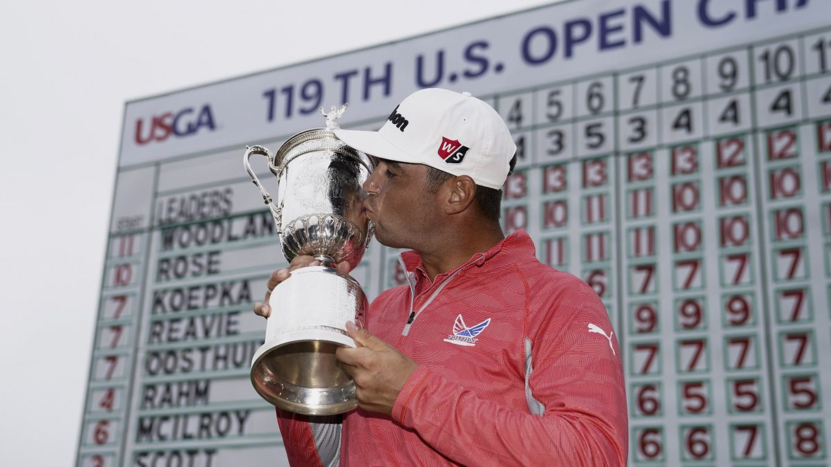 FILE - In this June 16, 2019, file photo, Gary Woodland kisses the U.S. Open trophy after...