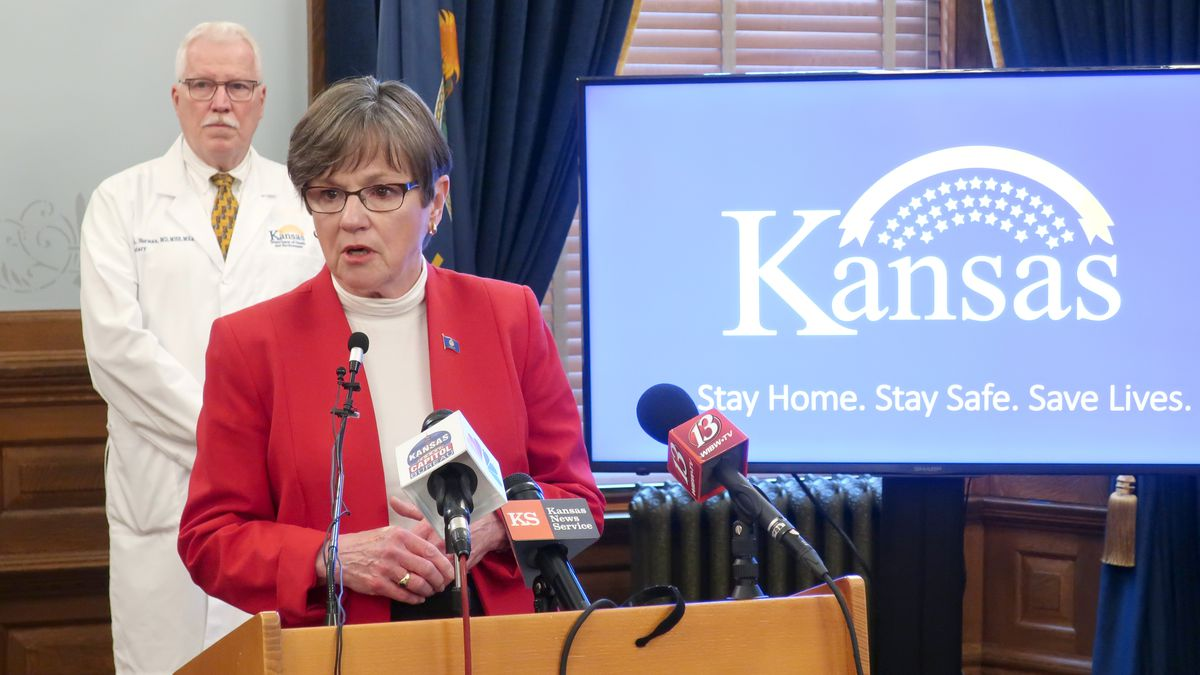 In this Friday, May 8, 2020 photo, Kansas Gov. Laura Kelly discusses the coronavirus pandemic during a news conference with Dr. Lee Norman, the state's top health administrator, at the Statehouse in Topeka, Kansas. (AP Photo/John Hanna)