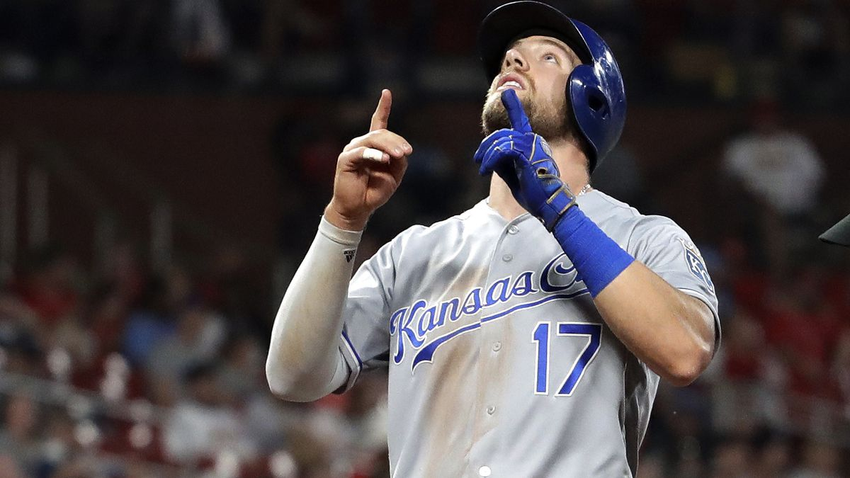 Kansas City Royals' Hunter Dozier points skyward as he arrives home after hitting a solo home run during the fifth inning in the second game of the team's baseball doubleheader against the St. Louis Cardinals on Wednesday, May 22, 2019, in St. Louis. (AP Photo/Jeff Roberson)