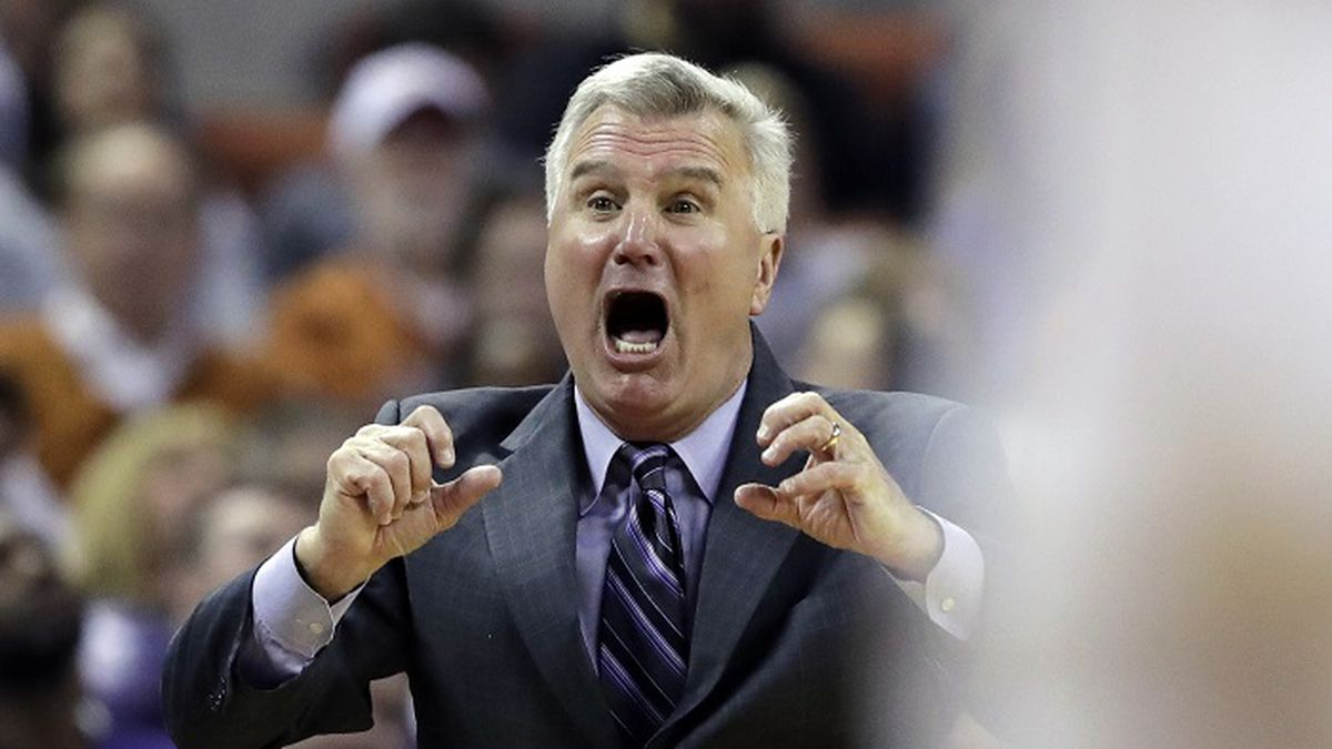Kansas State coach Bruce Weber yells to his players during the first half of an NCAA college...
