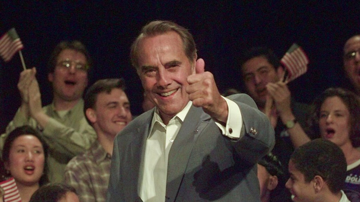 Former Sen. Bob Dole gives a thumb-up to supports as he enters a rally Thursday, May 16, 1996,...