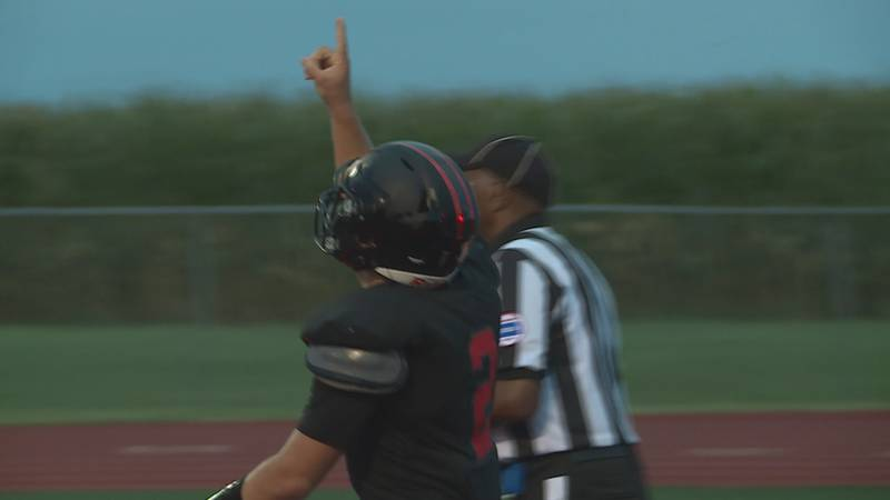 Rossville running back Corey Catron runs in a touchdown and points to the sky in honor of his...