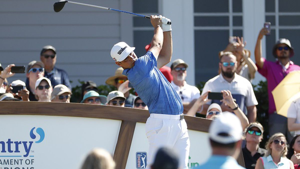Gary Woodland plays his shot from the first tee during the final round of the Tournament of Champions golf event, Sunday, Jan. 6, 2019, at Kapalua Plantation Course in Kapalua, Hawaii. (AP Photo/Matt York)
